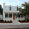 The Ashley River Cottage Plan by Allison Ramsey Architects built at Midtown Square in Beaufort, South Carolina. This variation is 1729 Heated Square Feet, 3 Bedrooms & 2 1/2 Bathrooms. Carolina Inspirations Book I, Page 83, C0075.