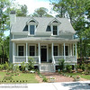 The Ashley River Cottage Plan by Allison Ramsey Architects built at Newpoint in Beaufort, South Carolina. This plan is 1533 Heated Square Feet, 3 Bedrooms & 2 1/2 Bathrooms. Carolina Inspirations Book I, Page 83, C0075.