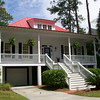 The Bermuda Bluff Cottage by Allison Ramsey Architects built on Fripp Island in Beaufort County, South Carolina. This plan is 2007 Heated Square Feet, 3 Bedrooms and 3 Bathrooms. Carolina Inspirations Book I, Page 19, C0002.