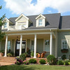 The Cumberland Plan by Allison Ramsey Architects. This plan is 4022 Heated Square Feet, 4 Bedrooms and 3 1/2 Bathrooms. Carolina Inspirations Book I, Page 23, C0022.
