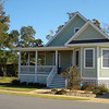 The Hayek Plan by Allison Ramsey Architects built at Cypress Cove in Manteo, North Carolina. This plan is 1727 Heated Square Feet, 3 Bedrooms & 3 Bathrooms. Carolina Inspirations Book I, Page 85, C0026.