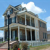 The Olivia plan by Allison Ramsey Architects built on Hutchinson Island near Savannah, Georgia. This plan is 1703 Heated Square Feet, 3 Bedrooms and 2 1/2 Bathrooms. Carolina Inspirations Book I, page 33, C0220.