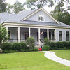 The Southwood Plan by Allison Ramsey Architects built at Coosaw Point in Beaufort, South Carolina. This plan is 2018 Heated Square Feet, 3 Bedrooms and 3 Bathrooms. Carolina Inspirations Book I, Page 24, C0230.