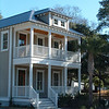 The Riley Plan by Allison Ramsey Architects built at Phillips Park in Mount Pleasant, South Carolina. This plan is 2076 Heated Square Feet, 3 Bedrooms and 2 1/2 Bathooms. Carolina Inspirations Book II, Page 10.
