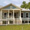The South Bay Cottage by Allison Ramsey Architects built on Duke Street in Downtown Beaufort, South Carolina. This plan is 1022 Heated Square Feet, 2 Bedrooms & 2 Bathrooms.