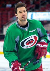 Radek Dvorak. March 29, 2014. Carolina Hurricanes players wear green commemorative  jerseys at warmups for Go Green Night at PNC Arena  (versus Columbus Blue Jackets).  Copyright © 2014 Jamie Kellner. All Rights Reserved.