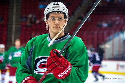 Jeff Skinner. March 29, 2014. Carolina Hurricanes players wear green commemorative  jerseys at warmups for Go Green Night at PNC Arena  (versus Columbus Blue Jackets).  Copyright © 2014 Jamie Kellner. All Rights Reserved.