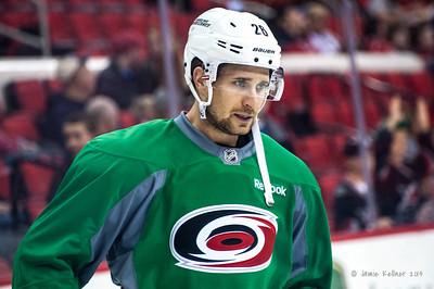John-Michael Liles. March 29, 2014. Carolina Hurricanes players wear green commemorative  jerseys at warmups for Go Green Night at PNC Arena  (versus Columbus Blue Jackets).  Copyright © 2014 Jamie Kellner. All Rights Reserved.