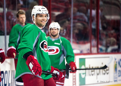 Andrej Sekera. March 29, 2014. Carolina Hurricanes players wear green commemorative  jerseys at warmups for Go Green Night at PNC Arena  (versus Columbus Blue Jackets).  Copyright © 2014 Jamie Kellner. All Rights Reserved.