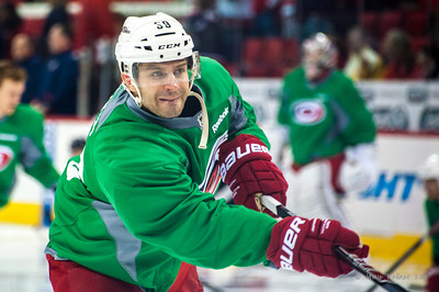 Patrick Dwyer. March 29, 2014. Carolina Hurricanes players wear green commemorative  jerseys at warmups for Go Green Night at PNC Arena  (versus Columbus Blue Jackets).  Copyright © 2014 Jamie Kellner. All Rights Reserved.
