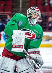 Anton Khudobin. March 29, 2014. Carolina Hurricanes players wear green commemorative  jerseys at warmups for Go Green Night at PNC Arena  (versus Columbus Blue Jackets).  Copyright © 2014 Jamie Kellner. All Rights Reserved.