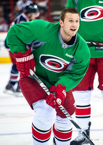 Jiri Tlusty. March 29, 2014. Carolina Hurricanes players wear green commemorative  jerseys at warmups for Go Green Night at PNC Arena  (versus Columbus Blue Jackets).  Copyright © 2014 Jamie Kellner. All Rights Reserved.