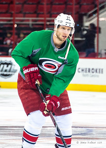 Jordan Staal. March 29, 2014. Carolina Hurricanes players wear green commemorative  jerseys at warmups for Go Green Night at PNC Arena  (versus Columbus Blue Jackets).  Copyright © 2014 Jamie Kellner. All Rights Reserved.