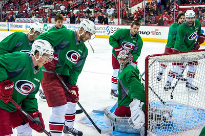 March 29, 2014. Carolina Hurricanes players wear green commemorative  jerseys at warmups for Go Green Night at PNC Arena  (versus Columbus Blue Jackets).  Copyright © 2014 Jamie Kellner. All Rights Reserved.