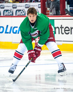 Alex Semin. March 29, 2014. Carolina Hurricanes players wear green commemorative  jerseys at warmups for Go Green Night at PNC Arena  (versus Columbus Blue Jackets).  Copyright © 2014 Jamie Kellner. All Rights Reserved.