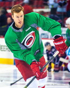 Riley Nash. March 29, 2014. Carolina Hurricanes players wear green commemorative  jerseys at warmups for Go Green Night at PNC Arena  (versus Columbus Blue Jackets).  Copyright © 2014 Jamie Kellner. All Rights Reserved.