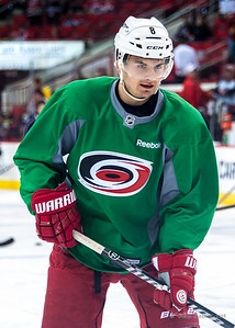 Andrei Loktionov. March 29, 2014. Carolina Hurricanes players wear green commemorative  jerseys at warmups for Go Green Night at PNC Arena  (versus Columbus Blue Jackets).  Copyright © 2014 Jamie Kellner. All Rights Reserved.