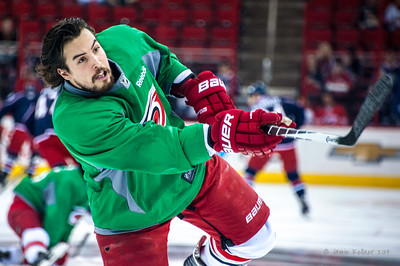 Justin Faulk. March 29, 2014. Carolina Hurricanes players wear green commemorative  jerseys at warmups for Go Green Night at PNC Arena  (versus Columbus Blue Jackets).  Copyright © 2014 Jamie Kellner. All Rights Reserved.