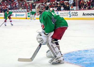Cam Ward. March 29, 2014. Carolina Hurricanes players wear green commemorative  jerseys at warmups for Go Green Night at PNC Arena  (versus Columbus Blue Jackets).  Copyright © 2014 Jamie Kellner. All Rights Reserved.