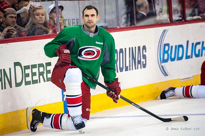 Jay Harrison. March 29, 2014. Carolina Hurricanes players wear green commemorative  jerseys at warmups for Go Green Night at PNC Arena  (versus Columbus Blue Jackets).  Copyright © 2014 Jamie Kellner. All Rights Reserved.