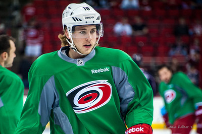 Elias Lindholm. March 29, 2014. Carolina Hurricanes players wear green commemorative  jerseys at warmups for Go Green Night at PNC Arena  (versus Columbus Blue Jackets).  Copyright © 2014 Jamie Kellner. All Rights Reserved.