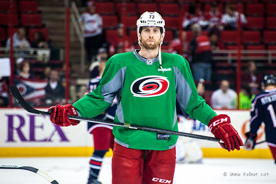 Brett Bellemore. March 29, 2014. Carolina Hurricanes players wear green commemorative  jerseys at warmups for Go Green Night at PNC Arena  (versus Columbus Blue Jackets).  Copyright © 2014 Jamie Kellner. All Rights Reserved.