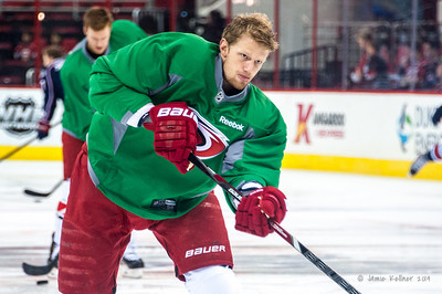 Eric Staal. March 29, 2014. Carolina Hurricanes players wear green commemorative  jerseys at warmups for Go Green Night at PNC Arena  (versus Columbus Blue Jackets).  Copyright © 2014 Jamie Kellner. All Rights Reserved.