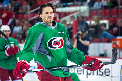 Ron Hainsey. March 29, 2014. Carolina Hurricanes players wear green commemorative  jerseys at warmups for Go Green Night at PNC Arena  (versus Columbus Blue Jackets).  Copyright © 2014 Jamie Kellner. All Rights Reserved.