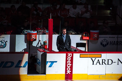 Tripp Tracy between the benches. April 10, 2014. Carolina Hurricanes vs. Washington Capitals, PNC Arena, Raleigh, NC. Copyright © 2014 Jamie Kellner. All Rights Reserved.
