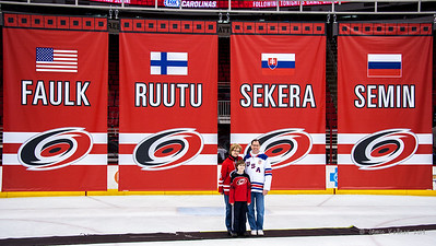 Posing with the Olympic banners. February 8, 2014. Carolina Hurricanes vs. Montreal Canadiens, PNC Arena, Raleigh, NC.  Copyright © 2014 Jamie Kellner. All Rights Reserved.