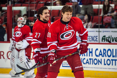 Justin Faulk and Alex Semin. January 25, 2014. Carolina Hurricanes vs. Ottawa Senators, PNC Arena, Raleigh, NC. Copyright © 2014 Jamie Kellner. All rights reserved.