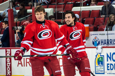 Alex Semin and Justin Faulk. January 25, 2014. Carolina Hurricanes vs. Ottawa Senators, PNC Arena, Raleigh, NC. Copyright © 2014 Jamie Kellner. All rights reserved.