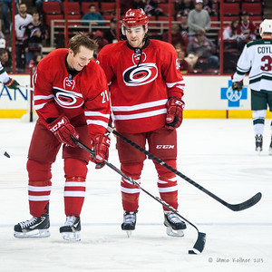 Drayson Bowman and Chris Terry. November 9, 2013.  Carolina Hurricanes vs. Minnesota Wild, PNC Arena, Raleigh, NC.  Copyright © 2013 Jamie Kellner. All rights reserved.