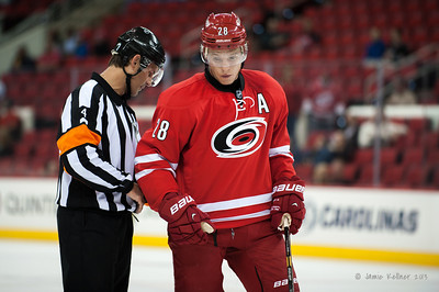 Alexander Semin gets in trouble for tucking his jersey.  September 18, 2013. Carolina Hurricanes vs. Columbus Blue Jackets (preseason), PNC Arena, Raleigh, NC.  Copyright © 2013 Jamie Kellner. All rights reserved.