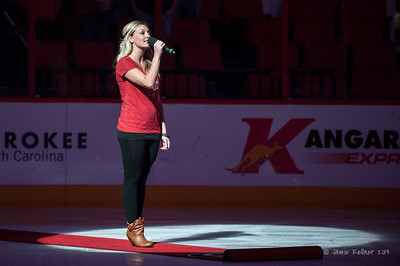 Anthem singer Amanda Kessell. September 27, 2013. Carolina Hurricanes vs. Buffalo Sabres (preseason), PNC Arena, Raleigh, NC.  Copyright © 2013 Jamie Kellner. All rights reserved.