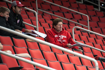 Detroit Red Wings head coach Mike Babcock observes Canes practice from the stands. October 4, 2013. Carolina Hurricanes vs. Detroit Red Wings, Opening Night at PNC Arena, Raleigh, NC.  Copyright © 2013 Jamie Kellner. All rights reserved.