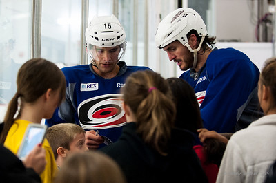 Tuomo Ruutu and Kevin Westgarth. October 12, 2013.  Carolina Hurricanes practice at Raleigh Center Ice, Raleigh, NC.  Copyright © 2013 Jamie Kellner. All rights reserved.