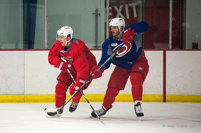 Jiri Tlusty and Kevin Westgarth. October 23, 2013. Carolina Hurricanes practice at Raleigh Center Ice, Raleigh, NC.  Copyright © 2013 Jamie Kellner. All rights reserved.
