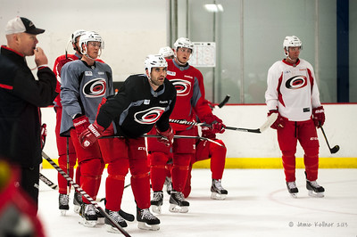 "Listening to Kirk Muller telling the ""ladies' to get it in gear. October 23, 2013. Carolina Hurricanes practice at Raleigh Center Ice, Raleigh, NC.  Copyright © 2013 Jamie Kellner. All rights reserved."