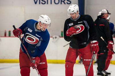 Drayson Bowman and Brett Bellemore. October 23, 2013. Carolina Hurricanes practice at Raleigh Center Ice, Raleigh, NC. Copyright © 2013 Jamie Kellner. All rights reserved.