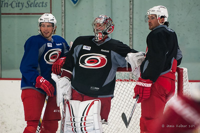 Elias Lindholm, Cam Ward, and Ron Hainsey chillin. October 23, 2013. Carolina Hurricanes practice at Raleigh Center Ice, Raleigh, NC.  Copyright © 2013 Jamie Kellner. All rights reserved.
