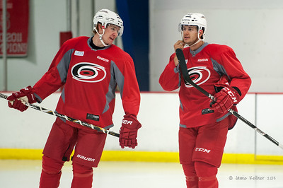 Zac Dalpe and Brett Sutter. September 13, 2013. Carolina Hurricanes training camp practice at Raleigh Center Ice, Raleigh, NC.  Copyright © 2013 Jamie Kellner. All rights reserved.