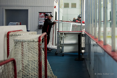 John MacLean and Rod Brind'Amour roll out the new nets. September 13, 2013. Carolina Hurricanes training camp practice at Raleigh Center Ice, Raleigh, NC.  Copyright © 2013 Jamie Kellner. All rights reserved.