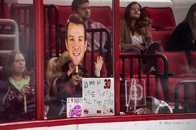 Cam Ward's son Nolan holds up signs for his dad during warmups