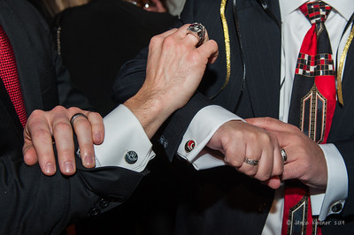 Ben and Doug show off their cufflinks. February 1, 2014. Carolina Hurricanes Casino Night and Wine Tasting, benefitting the Kids 'N Community Foundation, PNC Arena, Raleigh, NC.  Copyright © 2014 Jamie Kellner. All Rights Reserved.