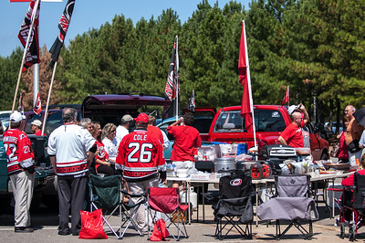 September 14, 2009.  Hurricanes players Jussi Jokinen, Joni Pitkanen, and Tuomo Ruutu hold a photo shoot for  Finnish sports magazine Veikkaaja in the RBC Center parking lot to a backdrop of tailgating Canes Fans.  © Jamie Kellner 2009. All rights reserved. Do not reproduce or reuse without express permission.