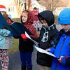 Theresa Letarte, 7, was watching some old Christmas movies and decided she wanted to go caroling. She talked her family and friends into doing it. Here they sing at one of the houses in her neighborhood. From left is Caylen St. George, Theresa, Jameson Harp, 7, and Nate Young, 7. SENTINEL & ENTERPRISE/JOHN LOVE