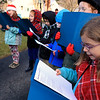 Theresa Letarte, 7, was watching some old Christmas movies and decided she wanted to go caroling. She talked her family and friends into doing it. Here they sing at one of the houses in her neighborhood. Caroline Brozozsky, 7, sings with the group of kids during their caroling on Saturday afternoon, December 22, 2018. SENTINEL & ENTERPRISE/JOHN LOVE