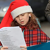 Theresa Letarte, 7, was watching some old Christmas movies and decided she wanted to go caroling. She talked her family and friends into doing it. Here her friend Caylen St. George sings at one of the houses as they caroled. SENTINEL & ENTERPRISE/JOHN LOVE