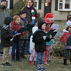 Theresa Letarte, 7, was watching some old Christmas movies and decided she wanted to go caroling. She talked her family and friends into doing it. Here they all sing at one of the houses in her neighborhood. SENTINEL & ENTERPRISE/JOHN LOVE